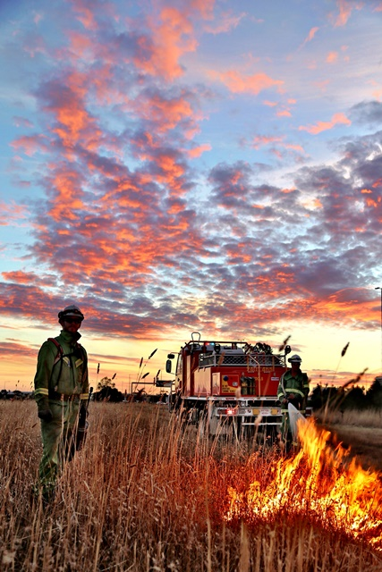 Image of firefighters at sunset by Paul Hitch